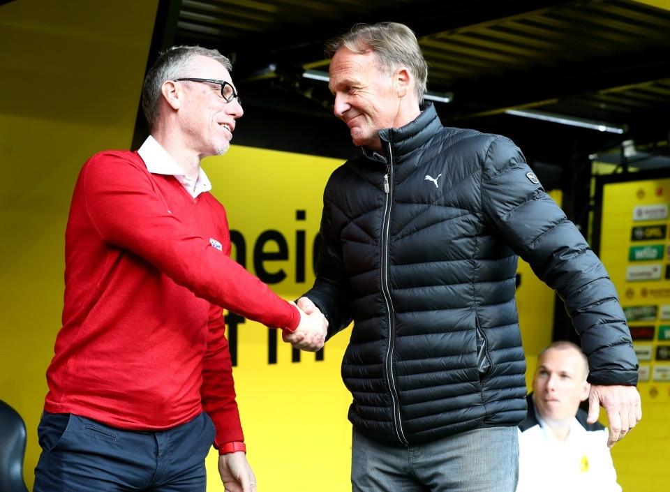 In der Hinrunde noch Rivalen, heute Partner: Peter Stöger und Aki Watzke
